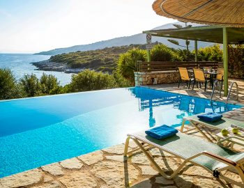 villa-ostria-sivota-lefkada-greece-pool-area-with-sunbeds