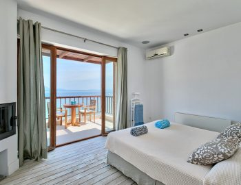villa-paleros-greece-master-bedroom-with-private-balcony
