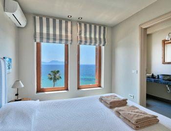 villa-scorpios-pogonia-paleros-greece-bedroom-with-ensuite-bathroom