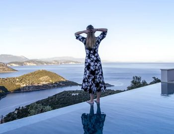 villa sky sivota lefkada greece girl standing on infinity pool