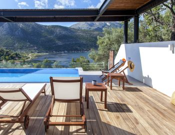 villa-theia-desimi-lefkada-greece-girl-reading-book-by-the-pool