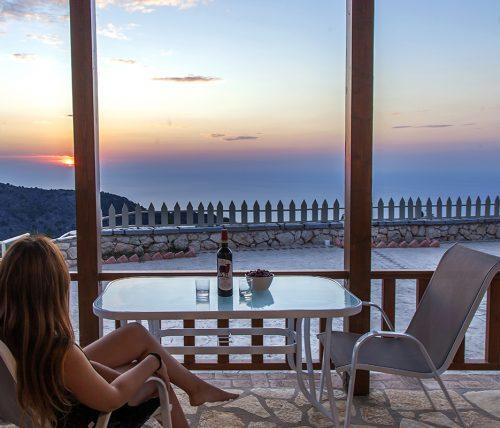 villa-vissala-arenaria-accommodation-lefkada-lefkas-xortata-girl-sitting-looking-at-sunset