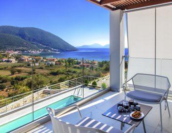 villa-w-offwhite-vasiliki-lefkada-greece-upper-level-master-bedroom-with-private-balcony-and-panoramic-sea-view-of-vasiliki
