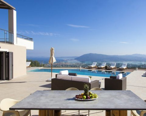 villa melia apolpena lefkada greece with large outdoor dinning table looking in lefkada town