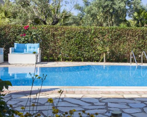 Villa-Aliki-in-lefkas-town-greece-the-pool-area-with-greenery-arround