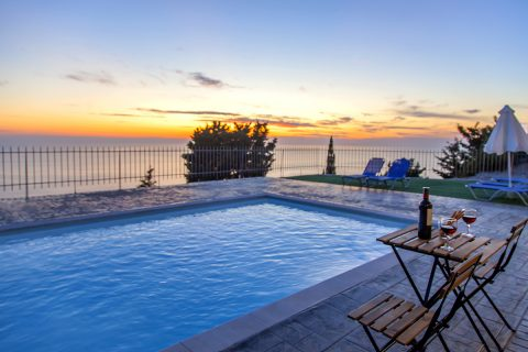 villa-mple-on-blue-athani-lefkada-greece-sunset-over-ionian-sea